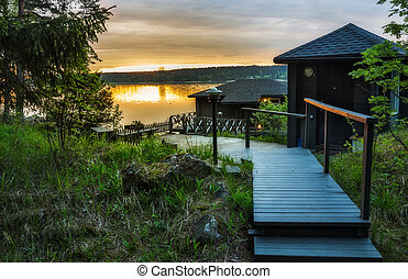 Landscape with a house on the lake in Karelia