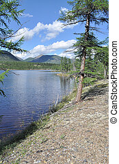 Landscape with a lake and mountains along the banks. - ...