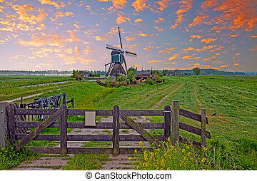 Landscape with a traditional windmill in the countryside from the Netherlands