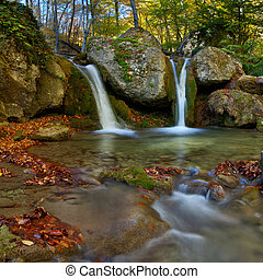 Landscape with autumn waterfall in the mountains - Landscape...