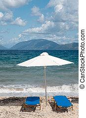 Beach at the Greek ionian island Kefalonia with parasols