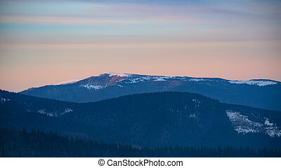Landscape with Beautiful Sunset in Winter Mountains.