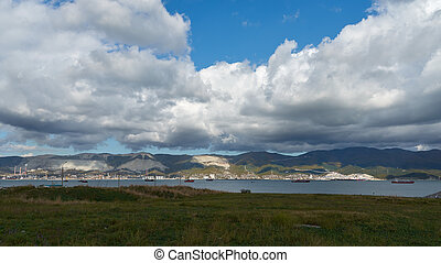 landscape with blue sky, clouds and sea