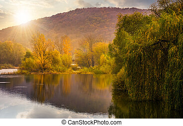 landscape with calm river in autumn at sunset. beautiful...