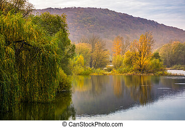 landscape with calm river in autumn. beautiful mountainous...