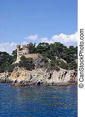 Landscape with castle view from sea in Lloret de Mar, Costa Brava, Spain.