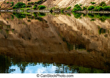 Landscape with cliff reflection in river. - Landscape with...