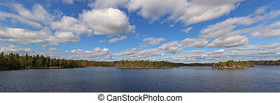 clouds over the forest lake