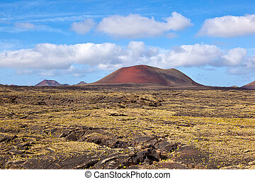 Landscape with cold lava flow and mountain