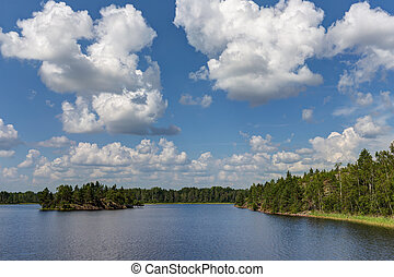cumulus clouds over the summer lake