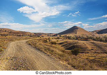 landscape with dirt road in the highlands