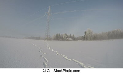snowdrift morning fog in fields - Landscape with electrical...