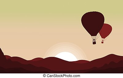 Landscape with flying balloon in the sky