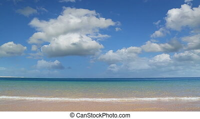 landscape with gold sand beach and clouds