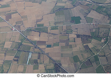 Landscape with green farmland patches, aerial shot.