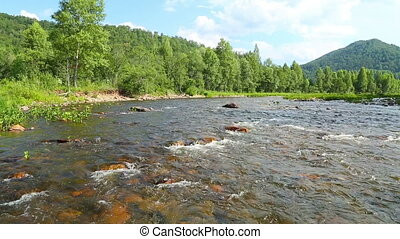 landscape with mountain river flowing over rocks at summer