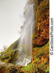 Landscape with mountain waterfall