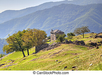 Landscape with old stone house in the mountain