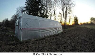 Landscape with polyethylene greenhouse, time lapse 4K -...