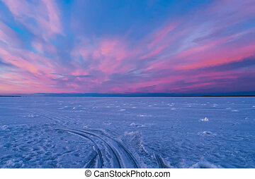 landscape with purple blue sunset on a winter evening over the river