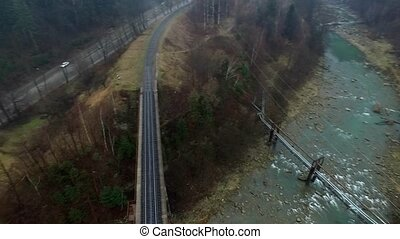 landscape with railway bridge and road in Carpathian mountains