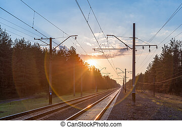 Landscape with railway on sunset