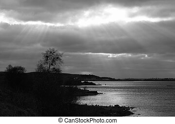 Landscape with rays of sun and lake