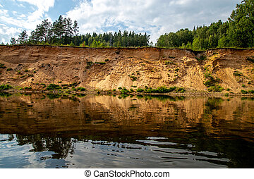 Landscape with river, and trees on the cliff in Latvia. -...