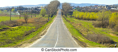 Landscape with road and village.
