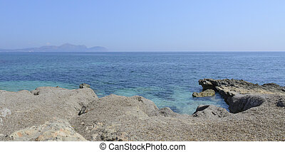Landscape with rocks and ocean.