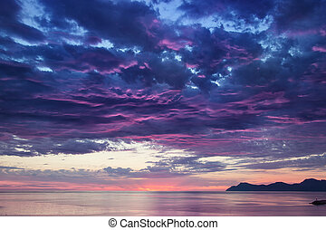 landscape with sea and mountains on sunrise