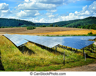 Landscape with solar energy field at sunny summer day