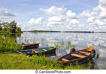 landscape with summer time boats on lake