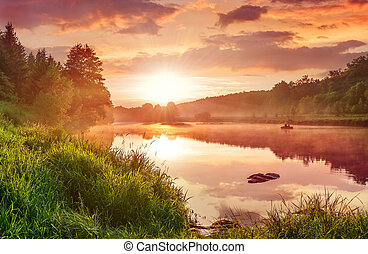 Landscape with sunset on the lake