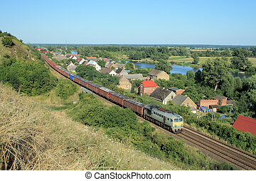 Landscape with the train, village and river - Freight train...