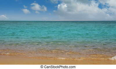 turquoise sea and golden sand beach