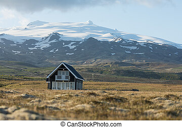 Landscape with typical house in Iceland.