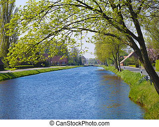 landscape with village by a beautiful canal