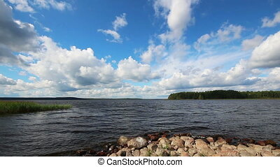 landscape with Vuoksa lake in Russia - timelapse clouds and...
