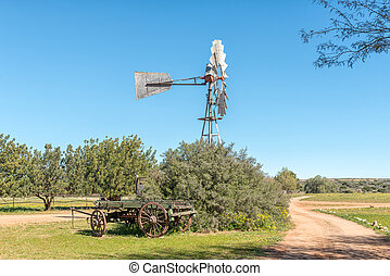 Landscape with windmill and ox-wagon at Papkuilsfontein
