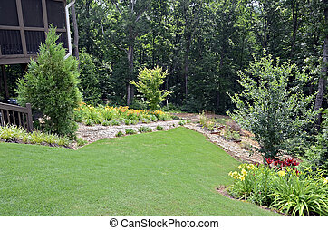 Landscaped Back Yard - A landscaped yard with flowers and...