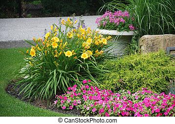 Landscaped flower garden - Landscaped garden with flowers...