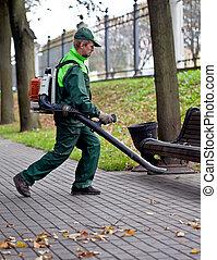 Landscaper with Leaf Blower at work - Landscaper operating ...