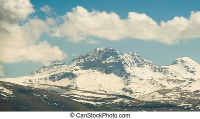 Landscapes and Mountains of Armenia. Clouds move over the Snowy Peaks of the Mountains in Armenia. Time lapse