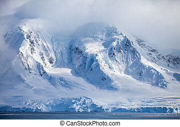 Landscapes Antarctica beautiful snow-capped mountains against the cloud sky