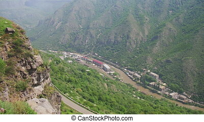 Landscapes of mountains in Armenia. Top view. The mountain river and Serpentine