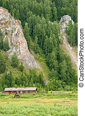 Landscapes of Siberia. Small settlements in mountainous places on the Kiya River. Kemerovo region. Russia.