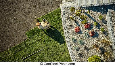 Aerial View of Gardener Installing Brand New Grass