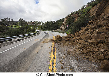 Winter storm related rock slide blocking Santa Susana Pass Road in Los Angeles, California.