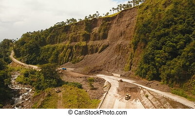 Landslide on the road in the mountains.Camiguin island Philippines.